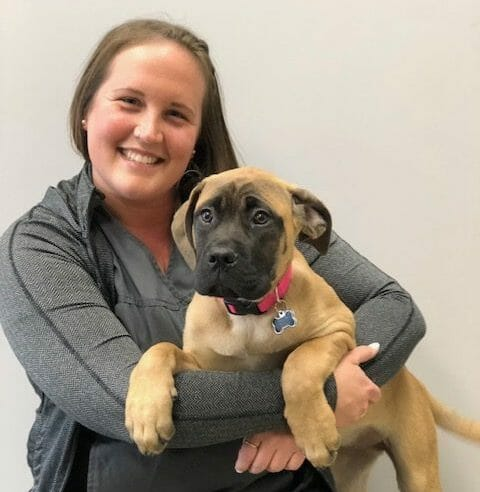 Mallory Wilton holding a dog