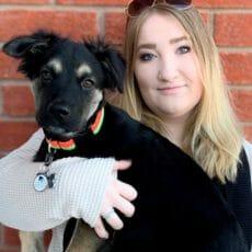 Samantha Roininen holding a dog